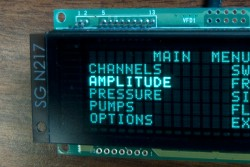 Y Series CU24063-Y1A VFD (vacuum fluorescent display) module close up with highlight effect applied to the menu
